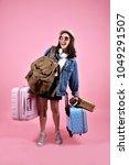 smiling asian woman traveler... | Shutterstock . vector #1049291507