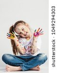 happy girl covered in paint... | Shutterstock . vector #1049294303