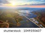 solar photovoltaic panels under ... | Shutterstock . vector #1049350607