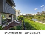 Modern Australian house overlooking the river - stock photo