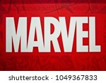 Small photo of Moscow, Russia - March, 2018: Marvel logo sign printed on banner. Marvel Comics Group is a publisher of American comic books and related media