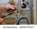 natural gas split gas line to... | Shutterstock . vector #1049374247