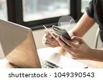 people use notebook and holding ... | Shutterstock . vector #1049390543
