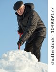Man Shovelling Fresh Snow From...