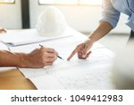close up of person's engineer... | Shutterstock . vector #1049412983