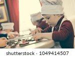 boys in cheefs hats making... | Shutterstock . vector #1049414507
