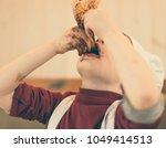 little boy eating chocolate... | Shutterstock . vector #1049414513