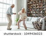 senior couple together at home... | Shutterstock . vector #1049436023