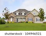 A new home with a landscaped yard. - stock photo