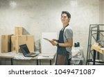 portrait owner in warehouse....   Shutterstock . vector #1049471087
