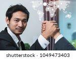business partners handshake... | Shutterstock . vector #1049473403
