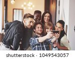 group of young multiracial... | Shutterstock . vector #1049543057