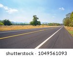 asphalt road and countryside...   Shutterstock . vector #1049561093