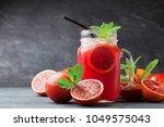 fresh orange lemonade drink or... | Shutterstock . vector #1049575043