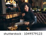 afro american woman happy in a... | Shutterstock . vector #1049579123
