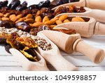 dried super foods on white wood ... | Shutterstock . vector #1049598857