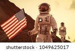 two astronauts explore mars ... | Shutterstock . vector #1049625017