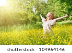 beautiful girl enjoying the summer sun outdoors in the park - stock photo