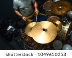 Small photo of Drummer playing on drum set top view. Live music concert, band recording process.Top view side of electronic modern drum kits set in a small music room