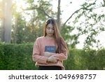 woman praying in the morning.... | Shutterstock . vector #1049698757