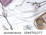 Small photo of Magnolia flower flat lay morning in bed concept composition. Top view