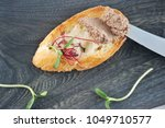 a sandwich of burnt toast with... | Shutterstock . vector #1049710577