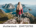 young blonde woman standing... | Shutterstock . vector #1049720783