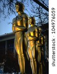LOS ANGELES, CA - 20 MARCH 1994: Oversize Academy Award statuettes line up outside the Dorothy Chandler Pavilion prior to the 66th Academy Awards show on 20 March 1994 in Los Angeles, CA - stock photo