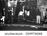 LOS ANGELES, CA - 29 APRIL 1992: Looters tear down storefronts on South Broadway in downtown Los Angeles during night one of the Rodney King Riots on 29 April 1992 in Los Angeles, CA. - stock photo