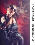 fashion rocker girl in a... | Shutterstock . vector #1049811977