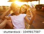 selfie time  two beautiful... | Shutterstock . vector #1049817587