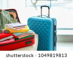 packed travel suitcases indoors | Shutterstock . vector #1049819813