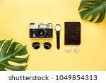 traveler accessories on yellow... | Shutterstock . vector #1049854313