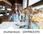 pensive exquisite african... | Shutterstock . vector #1049863193