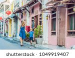 mom and son are tourists on the ... | Shutterstock . vector #1049919407