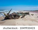 shipwreck on the skeleton coast ... | Shutterstock . vector #1049933423