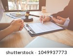 client and lawyer have a sit... | Shutterstock . vector #1049937773