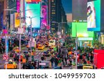 times square with neon art and... | Shutterstock . vector #1049959703