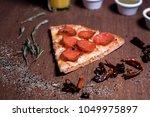 pepperoni pizza slice | Shutterstock . vector #1049975897