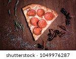 pepperoni pizza slice | Shutterstock . vector #1049976287
