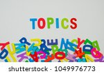 "Small photo of Colorful alphabet arrangement with word ""topics"""