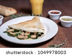 mushrooms crepe with spinach | Shutterstock . vector #1049978003