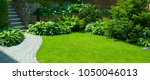 Stock photo garden stone path with grass growing up between the stones detail of a botanical garden 1050046013