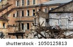an abandoned house collapses in ... | Shutterstock . vector #1050125813
