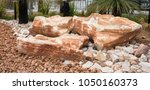 rock with garden landscaping     Shutterstock . vector #1050160373