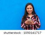 portrait of cute latino girl... | Shutterstock . vector #1050161717