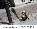 Small photo of Torun, Kuyavia-Pomerania, Poland - 23 July 2012: statue of comic strip dog Pilus