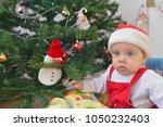 boy children playing near... | Shutterstock . vector #1050232403