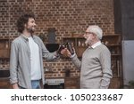 happy adult son and senior... | Shutterstock . vector #1050233687