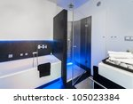 Modern black and white bathroom with shower and bath - stock photo